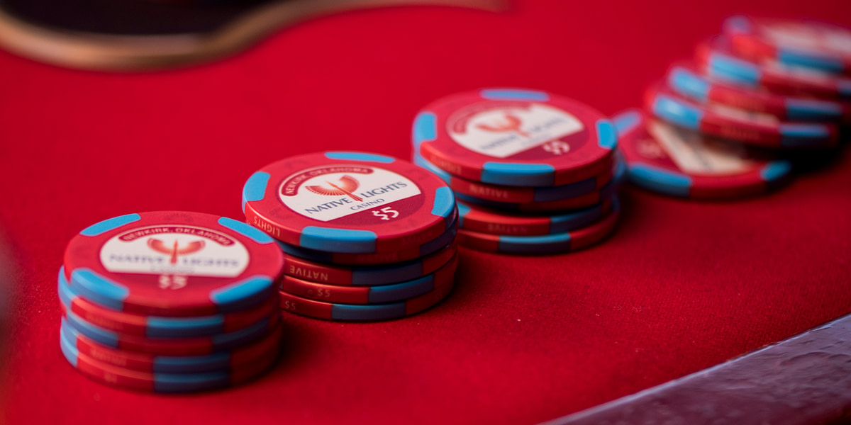 Native Lights Casino branding logo on a poker chip